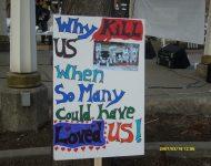 Why kill us…? Calgary sled dog vigil